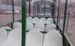 Tourist train white seats